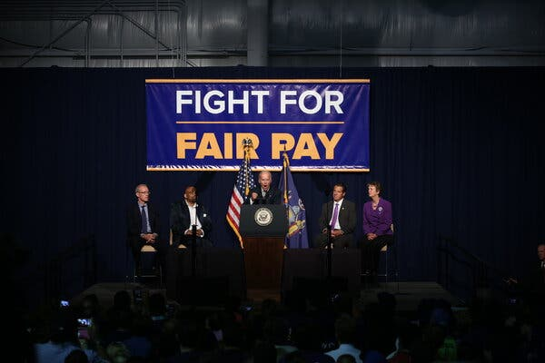 biden-to-raise-minimum-wage-for-federal-contractors-to-15-live-updates