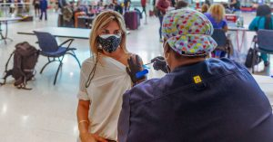 Delta Variant's Spread Prompts Reconsideration of Mask Guidance