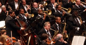 Musical Chairs? Why Swapping Seats Could Reduce Orchestra Aerosols.